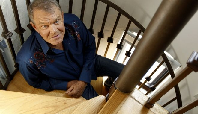 """In this July 27, 2011 photo, musician Glen Campbell poses for a portrait in Malibu, Calif. Campbell, the grinning, high-pitched entertainer who had such hits as """"Rhinestone Cowboy"""" and spanned country, pop, television and movies, died Tuesday, Aug. 8, 2017. He was 81. Campbell announced in June 2011 that he had been diagnosed with Alzheimer's disease. (AP Photo/Matt Sayles, File)"""