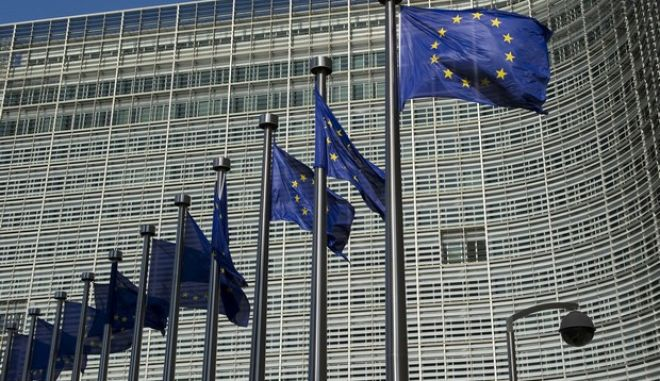 """European Union flags fly outside the European Commission headquarters building in Brussels, Belgium, on Wednesday, June 2, 2010. European Commission President Jose Manuel Barroso called for a """"commitment to keep the euro a strong and credible currency."""" Photographer: Jock Fistick/Bloomberg"""