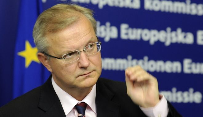 European Union Commissioner for Enlargement Olli Rehn talks to the media during a joint press conference with  Turkey's Foreign Affairs Minister Ahmet Davutoglu, unseen, following  their meeting at the EU Commission headquarter in Brussels Friday Oct. 2, 2009. (AP Photo/Thierry Charlier)