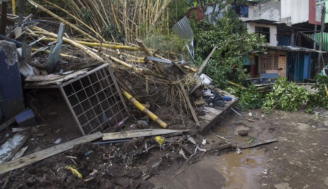 Debris caused by a landslide sits in a pile in the aftermath Tropical Storm Nate, on the outskirts of San Jose, Costa Rica, Friday, Oct. 6, 2017. Nate gained force as it sped toward Mexico's Yucatan Peninsula Friday after drenching Central America in rain that was blamed for at least 21 deaths.  (AP Photo/Moises Castillo)