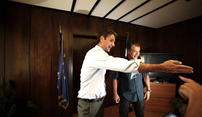 """Meeting of Minister for Administrative Reform Kyriakos Mitsotakis with the leader of the newly created political Party """"To Potami"""" Stayros Theodorakis, at the Ministry of Administrative reform, in Athens, on August 25, 2014 /        ,    ,  25 , 2014"""