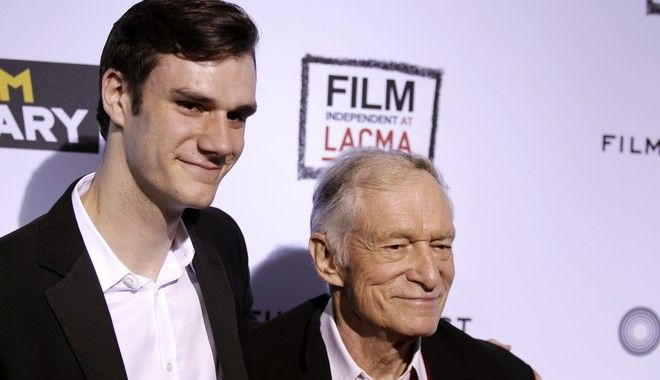 "Hugh Hefner, right, and his son, Cooper, arrive at the premiere of ""The Rum Diary"" in Los Angeles, Thursday, Oct. 13, 2011.  ""The Rum Diary"" opens in theaters Oct. 28, 2011. (AP Photo/Matt Sayles)"