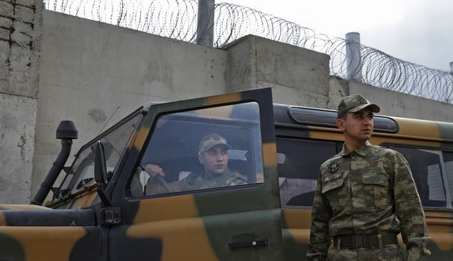Turkish army officers patrol next to the wall along the border with conflict-stricken Syria, that Turkey had been constructing to boost security, near the town of Kilis, southeastern Turkey, Thursday, March 2, 2017. The head of Turkey's Housing Development Administration said this week that more than half of the 511-kilometer concrete wall has been built. (AP Photo/Lefteris Pitarakis)