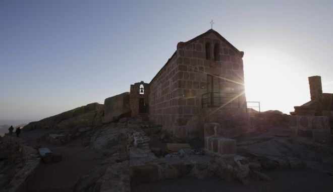 In this photo taken Sunday, Dec. 9, 2013, people climb down after visiting a Greek Orthodox Chapel on top of Mount Sinai in Saint Catherine in the Sinai peninsula, Egypt. (AP Photo/Hiro Komae)