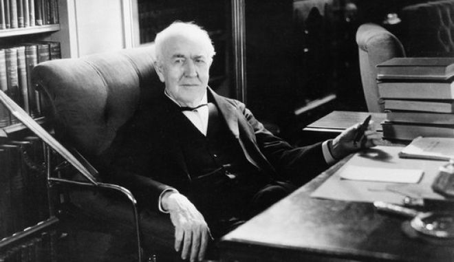 ** FILE ** This is an undatetd photo of iInventor Thomas Alva Edison as he sits at his desk in the family living room at the Glenmont mansion in Llewellyn Park, West Orange, N.J.  Edison is among 15 famous New Jerseyans selected as the first inductees to the New Jersey Hall of Fame. (AP Photo/File)