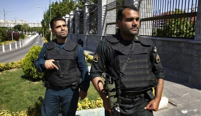 Police patrol outside Iran's parliament building after an assault by several attackers that was claimed by the Islamic State group, in Tehran, Iran, Wednesday, June 7, 2017. Gunmen and suicide bombers attacked Irans parliament and the shrine of its revolutionary leader, killing at least 12 people, wounding dozens and igniting an hours-long siege at the legislature that ended with four attackers dead. It marked the first time the Sunni extremists have taken responsibility for an assault in Shiite-majority Iran. (AP Photo/Ebrahim Noroozi)