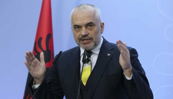 Albania's Prime Minister Edi Rama speaks during a news conference after a vote to appoint a temporary prosecutor general, which opposition consider to be unconstitutional in Tirana, Monday, Dec. 18, 2017. Albanian police clashed with opposition supporters who tried to force their way into parliament to disrupt a vote on the appointment of an interim prosecutor general. (AP Photo/Hektor Pustina)
