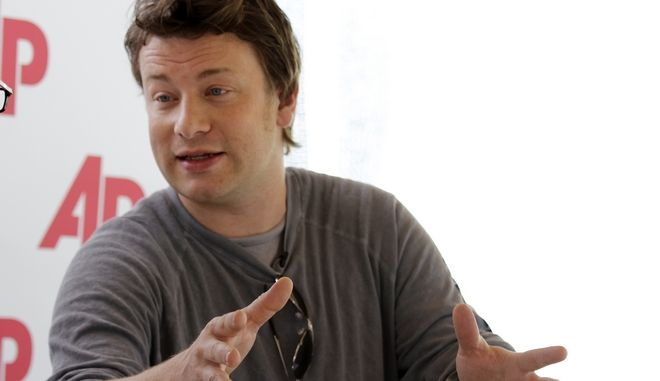 Celebrity chef Jamie Oliver speaks to The Associated Press in Miami Beach, Fla., at the South Beach Wine and Food Festival, Saturday, Feb. 26, 2011. Oliver began his career in England as the Naked Chef, introducing home cooks to his simple, but bold take on cooking. He later refocused to teach the basics of healthy cooking, including his efforts to reform school lunches. Oliver talked about the politics of food. (AP Photo/J Pat Carter)