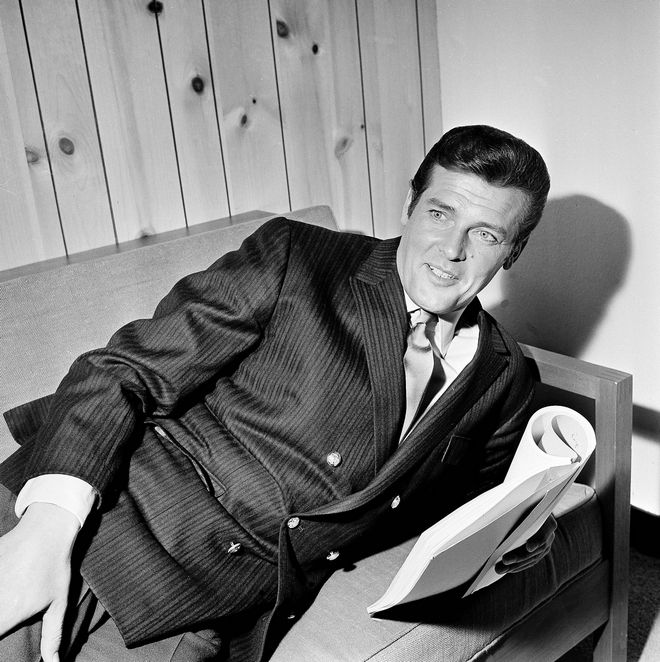 British actor Roger Moore is seen in his dressing room at the Elstree Studios, Boreham Wood, England, during an interview with a reporter, May 16, 1968.  (AP Photo/Bob Dear)