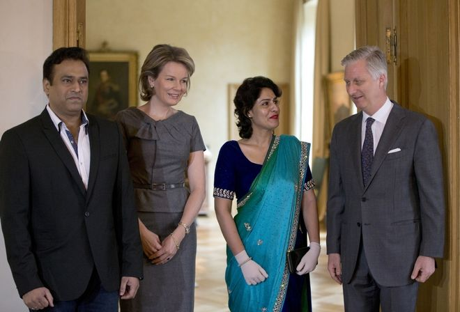 Belgium's King Philippe, right, and Belgium's Queen Mathilde, second left, greet India's Nidhi Chapekar, second right, and her husband Rupesh Chapekar, left, during a meeting at the Royal Palace in Brussels on Monday, March 20, 2017. Chaphekar, 40, a Jet Airways attendant and mother of two from Mumbai is one of the victims of the attacks on Brussels airport on March 22, 2016. (AP Photo/Virginia Mayo)