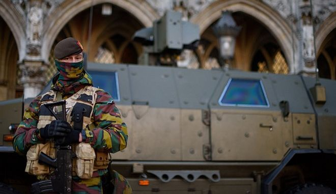 BRUSSELS, BELGIUM - NOVEMBER 23: An armed soldier stands guard over Stadhuis Van Brussel in Grote Markt on November 23, 2015 in Brussels, Belgium. Security has been tightened in the nation's capital after police arrested sixteen suspected terrorists during more than 22 anti-terror raids around the city yesterday.  (Photo by Ben Pruchnie/Getty Images)