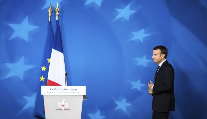 French President Emmanuel Macron prepares to address a media conference at the conclusion of an EU summit in Brussels on Friday, Oct. 20, 2017. European Union leaders gathered Friday to weigh progress in negotiations on Britain's departure from their club as they look for new ways to speed up the painfully slow moving process. (AP Photo/Geert Vanden Wijngaert)