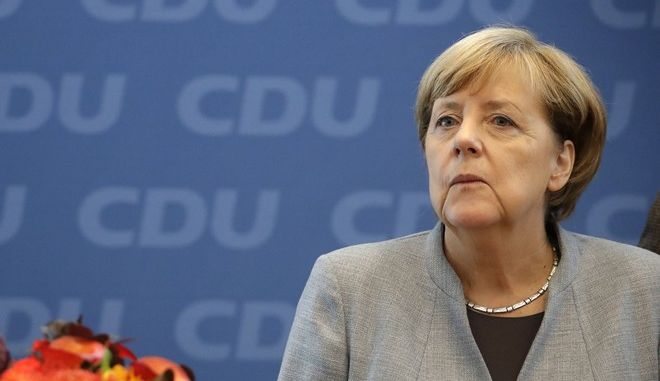 German Chancellor Angela Merkel looks on prior to a board meeting of the Christian Democratic Union CDU in Berlin, Germany, Monday, Sept. 25, 2017, the day after the German parliament election. (AP Photo/Matthias Schrader)