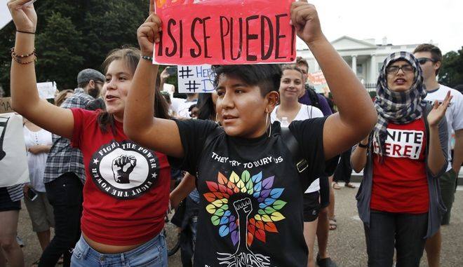 Juliana Torres, 16, left, and Micaela Lattimer, 16, both of Baltimore, rally in support of Deferred Action for Childhood Arrivals, known as DACA, outside of the White House, in Washington, Tuesday, Sept. 5, 2017.  President Donald Trump plans to end a program that has protected hundreds of thousands of young immigrants brought into the country illegally as children and call for Congress to find a legislative solution. (AP Photo/Jacquelyn Martin)