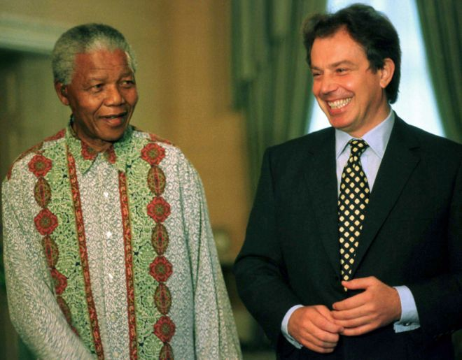 President Nelson Mandela shares a joke with British Labour Party leader Tony Blair after their meeting, October 11. Blair is on a short visit to the country to attend a meeting of the Commonwealth Press Union.  SAFRICA BLAIR - RTRUFL