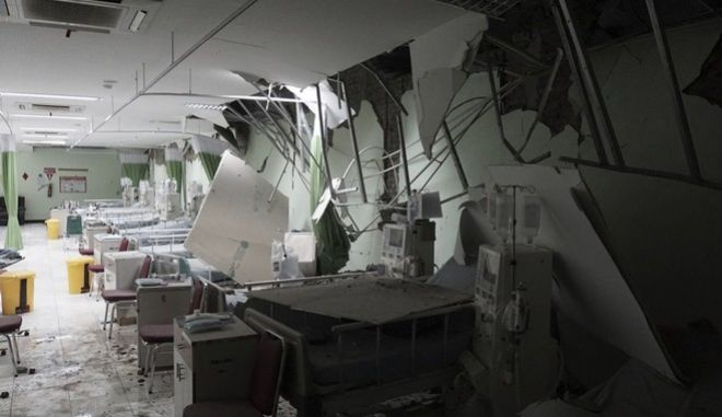 Damaged equipments are seen at a hospital following an earthquake in Banyumas, Central Java, Indonesia, Saturday, Dec. 16, 2017. A strong earthquake has shaken Indonesia's densely populated Java island, causing severe damage to dozens of homes near the epicenter. (Agus Fitrah)