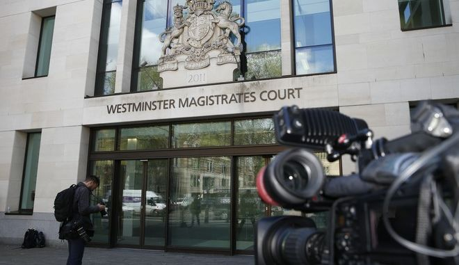 Members of the media wait outside Westminster Magistrates Court, in London Tuesday, April 18, 2017. British police on Tuesday arrested Indian business tycoon Vijay Mallya in London on behalf of authorities in India, where he is wanted on charges of money laundering and bank demands that he pay back more than a billion dollars in loans extended to his now-defunct airline. (AP Photo/Alastair Grant)