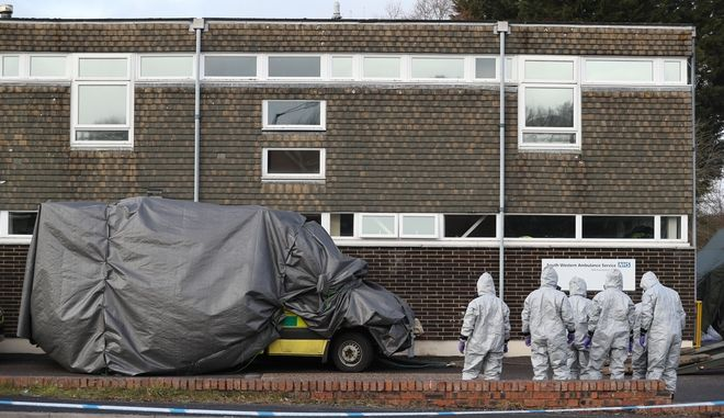 Investigators in gas masks prepare to move an ambulance at the South Western Ambulance Service station in Harnham, near Salisbury, England, as police and members of the armed forces probe the suspected nerve agent attack on Russian spy double agent Sergei Skripal, Saturday March 10, 2018. Counter-terrorism police asked for military assistance to remove vehicles and objects from the scene in the city, much of which has been cordoned off over contamination fears of the nerve agent poisoning of former spy Sergei Skripal and his daughter. (Andrew Matthews/PA via AP)