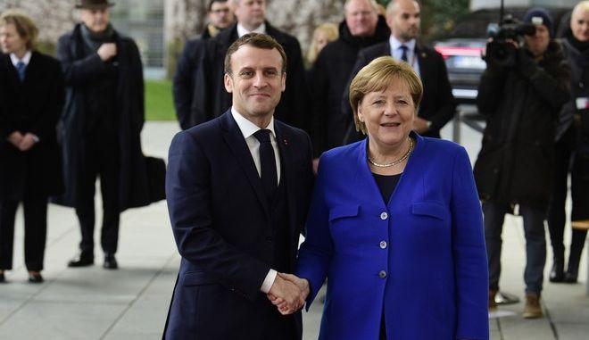 Η καγκελάριος της Γερμανίας Άγγελα Μέρκελ και ο πρόεδρος της Γαλλίας Εμμανουέλ Μακρόν