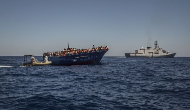 About 1,000 refugees and migrants, mostly from Eritrea but also from Somalia, Ghana, Libia, Syria and other countries, are rescued by the Italian army helped by the Spanish Proactiva's team, 17 miles north of Sabratha, Lybia, on Tuesday, July 19, 2016. (AP Photo/Santi Palacios)