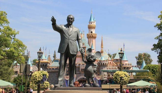 Anaheim, California, USA - May 30, 2014: Statue of Walt Disney and Mickey Mouse, known as Disney Partnes Statue, is welcoming all guests right in front of Sleeping Beauty Castle at Disneyland.