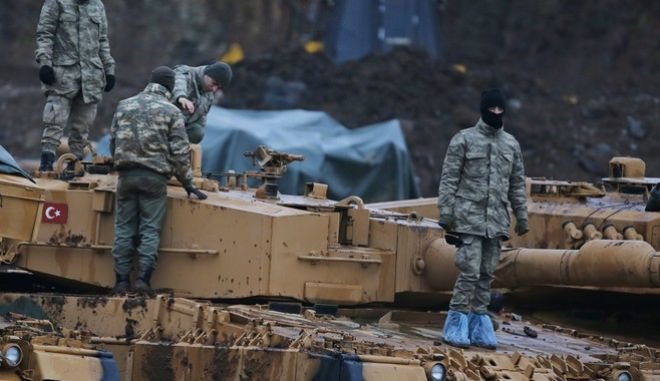 Turkish soldiers prepare their tanks to enter combat and join a military offensive on a Kurdish-held enclave in northern Syria, at a staging area in the Hatay province Turkey near the the border with Syria.Turkey launched an operation, codenamed Olive Branch, last week against the Syrian Kurdish People's Protection Units in Afrin, Syria that it deems a terror group. The operation codenamed Olive Branch is on its fourth day. (AP Photo/Lefteris Pitarakis)