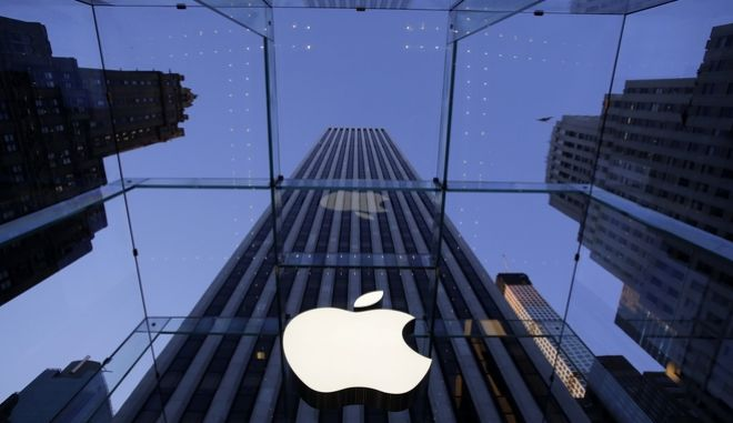 In this Sept. 5, 2014 photo, the Apple logo hangs in the glass box entrance to the company's Fifth Avenue store, in New York. Apple on Wednesday, Oct. 8, 2014 sent invites to an Oct. 16 event during which its expected to show off new models of its popular iPad and an update to its Mac OS system.(AP Photo/Mark Lennihan)