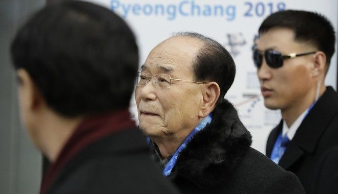 North Korea's nominal head of state Kim Yong Nam, center, arrives with South Korean Unification Minister Cho Myoung-gyon, left, at the Jinbu train station in Pyeongchang, South Korea, Friday, Feb. 9, 2018. In a stunning turn of events, North Korean leader Kim Jong Un's younger sister arrived in South Korea on Friday to be her brother's special envoy to the Pyeongchang Winter Olympics. (AP Photo/Lee Jin-man)