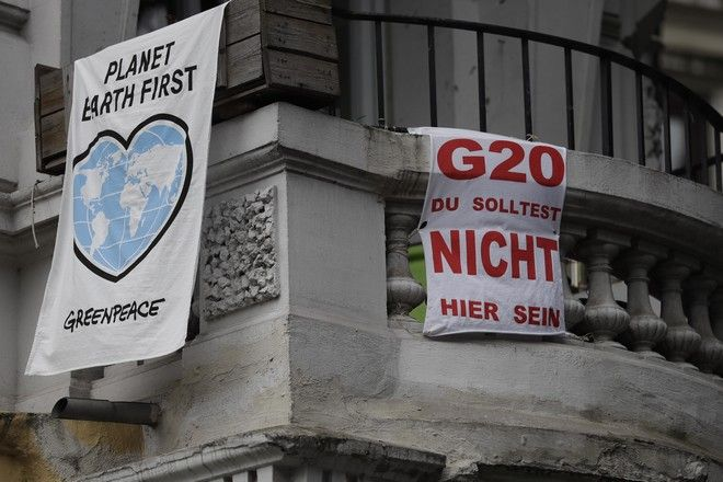 A balcony with G-20 protest slogans is pictured prior to the upcoming G-20 summit in Hamburg, Germany, Tuesday, July 4, 2017. Hamburg will host the G-20 summit on July 7 and July 8. (AP Photo/Matthias Schrader)