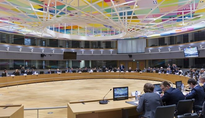 View of the round table meeting of Eurogroup finance ministers at the EU Council building in Brussels on Monday, Feb. 20, 2017. The eurozone's 19 finance ministers will be looking to defuse the risk of another Greek crisis as they try to agree Monday on what reforms Greece must still take to qualify for more loans. (AP Photo/Thierry Monasse)