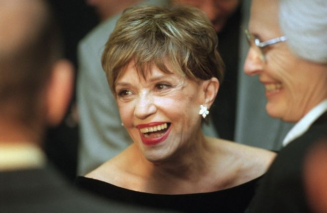 Legendary French actress Jeanne Moreau laughs as she mingles with guests at the Academy of Motion Pictures Arts and Sciences tribute to her, Thursday, Oct. 1, 1998 in Beverly Hills, California. American actress Sharon Stone served as moderator for the event. At right in the photo is American Film Institute director Jean Firstenberg. (AP Photo/Chris Pizzello)