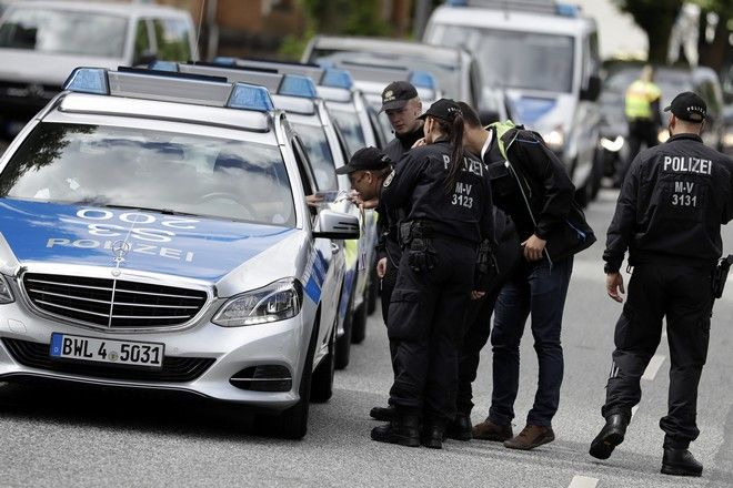 Police officers gather around the fair halls for the upcoming G-20 summit in Hamburg, Germany, Tuesday, July 4, 2017. Hamburg will host the G-20 summit on July 7 and July 8. (AP Photo/Matthias Schrader)