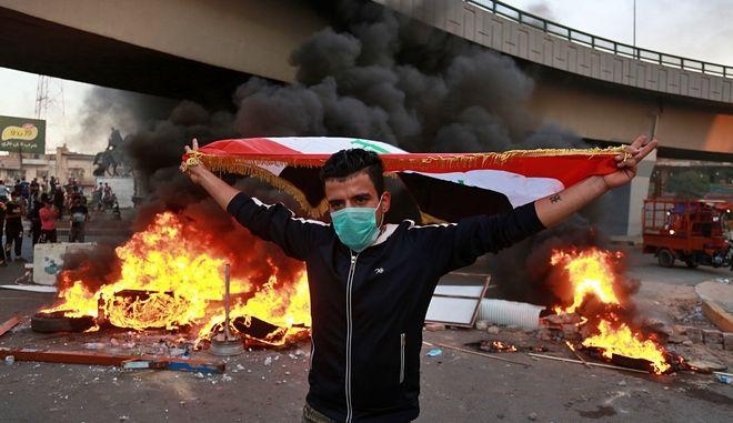 Διαδηλωτής στο Ιράκ