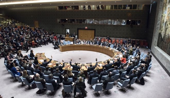 In this Monday, Dec. 18, 2017 photo, the Security Council votes on a resolution concerning Jerusalem's status at United Nations headquarters. The United States on Monday vetoed a resolution supported by the 14 other U.N. Security Council members that would have required President Donald Trump to rescind his declaration of Jerusalem as the capital of Israel, a vote that showed the depth of global opposition to the U.S. move. (Kim Haughton/United Nations via AP)
