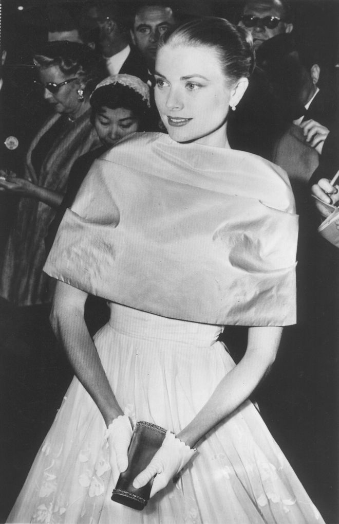Grace Kelly pauses in the lobby of the Pantages Theater after arriving at the Academy Awards ceremony in Hollywood, Calif., March 21, 1956. (AP Photo)