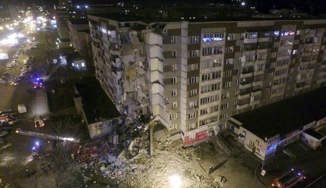 This photo provided by the Russian Emergency Situations Ministry made from tv footage shows a collapsed section of a nine-story apartment building, in Izhevsk, Russia, Thursday, Nov. 9, 2017. A nine-story apartment building partially collapsed Thursday in western Russian, killing at least three people and injuring another three, officials said. (Russian Ministry for Emergency Situations photo via AP)