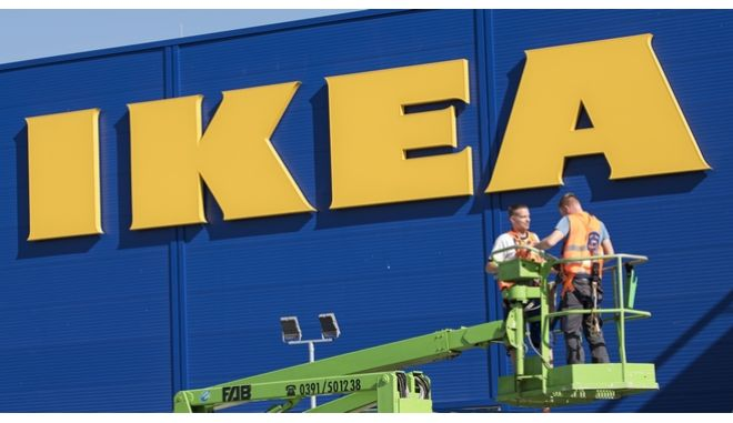 Workesr drive with their lifting platform in front of the new IKEA furnishing store in Magdeburg, Germany, Wednesday Aug. 23, 2017. The IKEA Group owns 340 stores in 28 countries. (AP Photo/Jens Meyer)