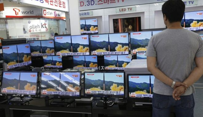 FILE- In this July 6, 2017 file photo, a man watches TV screens in an electronics shop showing a news program's report on North Korea's missile firing in Seoul, South Korea. North Korea fired a ballistic missile Friday night, July 28, which landed in the ocean off Japan, Japanese officials said. (AP Photo/Ahn Young-joon, File)
