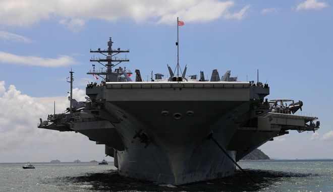 The USS Ronald Reagan aircraft carrier arrives in Hong Kong, Monday, Oct. 2, 2017. A senior U.S. Navy commander of the nuclear powered aircraft carrier reportedly participating in joint drills with South Korea later this month told reporters during a stop in Hong Kong on Monday that his strike group is committed to defending U.S. allies in the region. (AP Photo/Vincent Yu)