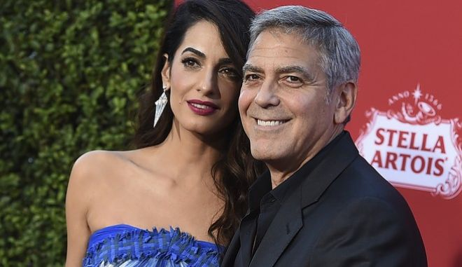 "Amal Clooney and George Clooney arrive at the Los Angeles premiere of ""Suburbicon"" on Sunday, Oct. 22, 2017 in Los Angeles. (Photo by Jordan Strauss/Invision/AP)"