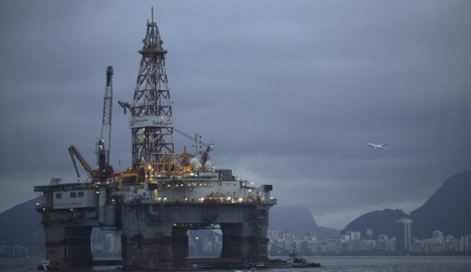 An oil platform is seen in the waters of the Guanabara bay in Niteroi, Brazil, Tuesday, April 21, 2015. Brazil's state-run oil company Petrobras says it lost $2.1 billion because of inflated contracts and other costs related to a long-running kickback scheme. Federal prosecutors have called the scheme the biggest corruption case ever uncovered in Brazil. They stress that they are still investigating and says the scope of the case continues to widen. (AP Photo/Leo Correa)