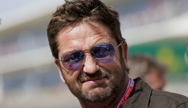 Actor Gerard Butler arrives for the Formula One U.S. Grand Prix auto race at the Circuit of the Americas, Sunday, Oct. 23, 2016, in Austin, Texas. (AP Photo/Tony Gutierrez)