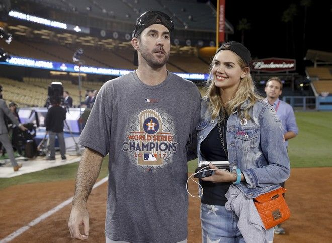 Houston Astros' Justin Verlander celebrates with Kate Upton after Game 7 of baseball's World Series against the Los Angeles Dodgers Wednesday, Nov. 1, 2017, in Los Angeles. The Astros won 5-1 to win the series 4-3. (AP Photo/Jae C. Hong)