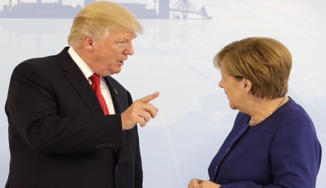 U.S. President Donald Trump, left, and German Chancellor Angela Merkel pose for a photograph prior to a bilateral meeting on the eve of the G-20 summit in Hamburg, northern Germany, Thursday, July 6, 2017. The leaders of the group of 20 meet July 7 and 8. (AP Photo/Matthias Schrader, pool)
