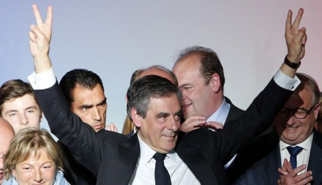 French conservative presidential candidate Francois Fillon gives victory signs  at the end of his campaign meeting in Lille, northern France, Tuesday, April, 18, 2017. The two-round presidential election is set for April 23 and May 7. (AP Photo/Michel Spingler)