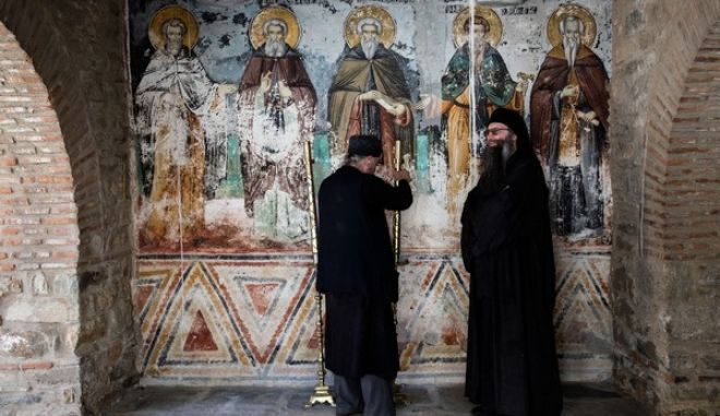 Russian President Vladimir Putin visits  the Protaton in Karyes, the administrative centre of the all-male Orthodox monastic community of Mount Athos, in  Karyes on May 28, 2016. /               28 , 2016