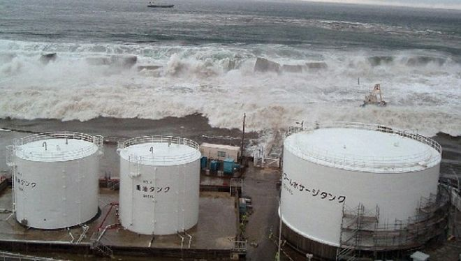 In this March 11, 2011, photo release Thursday, May 19 by Tokyo Electric Power Co.  waves of tsunami come toward tanks of heavy oil for the Unit 5 of the Fukushima Dai-ichi nuclear complex in Okuma, Fukushima Prefecture, northeastern Japan. (AP Photo/Tokyo Electric Power Co.) EDITORIAL USE ONLY