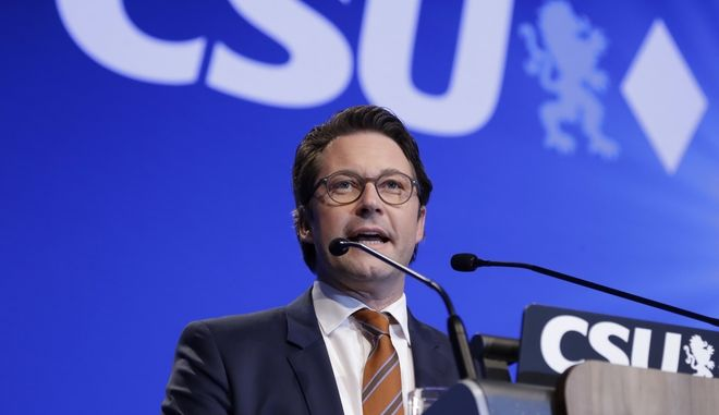 Andreas Scheuer, Secretary General of German Christian Social Union party, CSU, delivers his opening speech at a party convention of the German Christian Social Union, CSU, in Munich, Germany, Friday, Nov. 4, 2016. (AP Photo/Matthias Schrader)