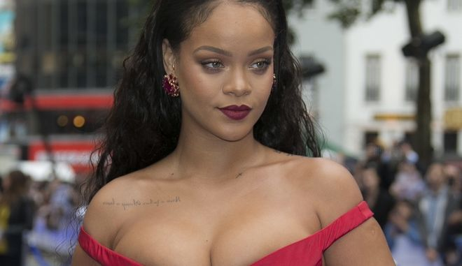Rihanna poses for photographers as she arrives for the European film premiere of 'Valerian and the City of a Thousand Planets' in London, Monday, July 24, 2017. (Photo by Joel Ryan/Invision/AP)