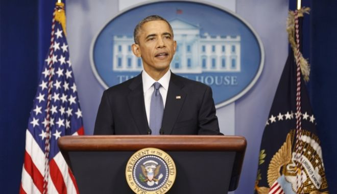 U.S. President Barack Obama speaks during his end of the year press conference in the briefing room of the White House in Washington, December 19, 2014. Obama and his family plan to depart Washington later in the day to spend the holidays in Hawaii. REUTERS/Larry Downing (UNITED STATES  - Tags: POLITICS)